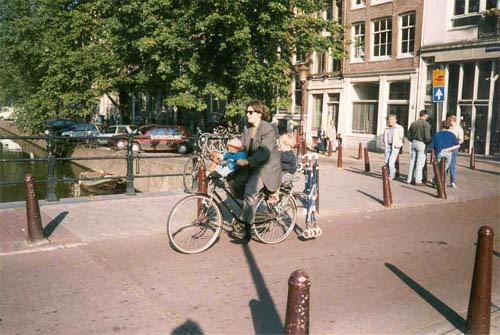 Mom with two children on one bike in Holland