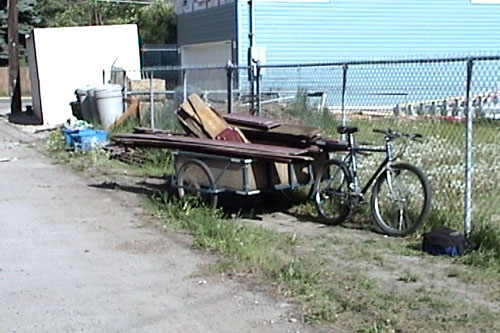 Home made bicycle trailer carrying a roundabout