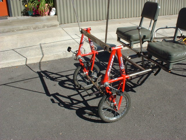 2 seat 3 wheel bike made from kid bikes and tubing