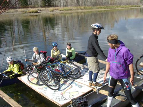Loading the bikes on the river crossing canoes